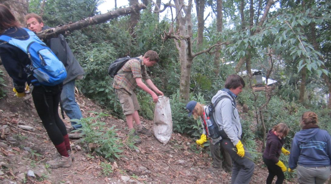 Mountain conservation volunteers in Nepal cleaning up litter.
